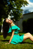 Stylish woman girl on casual green dress Royalty Free Stock Images