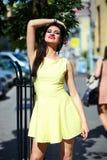 Stylish woman girl in casual yellow dress Stock Photos