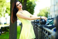 Stylish woman girl in casual yellow dress Royalty Free Stock Photos