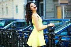 Stylish woman girl in casual yellow dress Stock Images