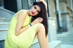 Stylish woman girl in casual yellow dress Royalty Free Stock Images