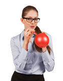 Woman with glasses inflating a rubber balloon Royalty Free Stock Photo