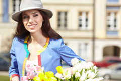 Stylish woman in gray hat on a bicycle Stock Photos