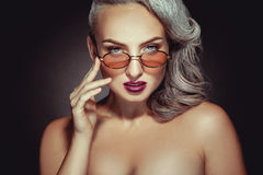 Stylish woman with grey hair color and nice makeup in sunglasses Royalty Free Stock Photo