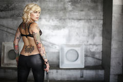 Stylish woman with gun Stock Images