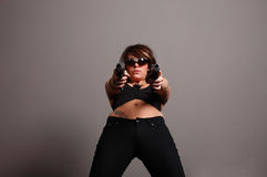 Stylish woman with guns Stock Photography