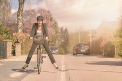Stylish woman having fun riding to work stock image