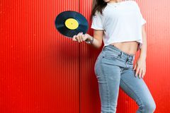 Woman holding a vinyl record Stock Image
