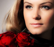 Stylish woman holding roses flower Stock Images
