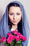 Stylish woman holding roses flower Royalty Free Stock Photo