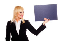 Stylish woman holding up a grey card Royalty Free Stock Photo