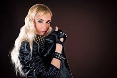 Stylish woman in a leather jacket. Beautiful stylish woman in a leather jacket royalty free stock image