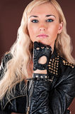 Stylish woman in a leather jacket Stock Images