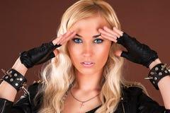 Stylish woman in a leather jacket. Beautiful stylish woman in a leather jacket stock photography