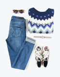 Stylish woman look. Woman/girl outfit on white background. Blue denim jeans , aztek print sweater, flower print sneakers, retro su Royalty Free Stock Photos