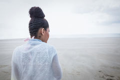 Stylish woman looking out to sea Royalty Free Stock Photography