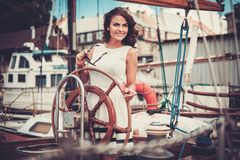 Stylish woman on a luxury regatta Stock Photo