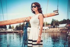 Stylish woman on a luxury regatta Royalty Free Stock Image