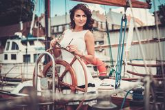 Stylish woman on a luxury regatta Stock Image