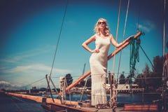 Stylish woman on a luxury regatta Stock Photos