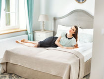 Stylish woman lying in the bedroom Stock Photography