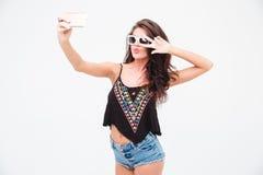 Stylish woman making selfie photo Stock Images