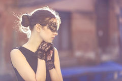 Stylish Woman with Masquerade Mask and Lace Gloves Stock Photos