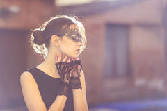 Stylish Woman with Masquerade Mask and Lace Gloves Royalty Free Stock Image