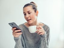 Stylish Woman, Mobile Phone And Cup Of Coffee Royalty Free Stock Image