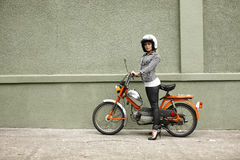 Stylish woman with moped Royalty Free Stock Photo