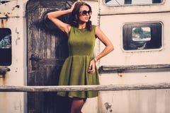 Stylish woman on old boat Stock Image