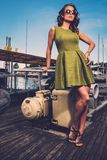 Stylish woman on old boat Royalty Free Stock Photo