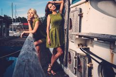 Stylish woman on old boat Royalty Free Stock Photos