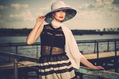 Stylish woman on old wooden pier Stock Photos