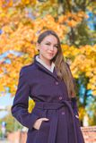 Stylish woman out walking in autumn Stock Images
