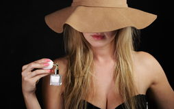 Stylish woman with perfume bottle on black Royalty Free Stock Image