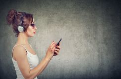 Stylish woman with phone listening to music stock photography