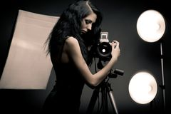 Stylish woman photographer Stock Images