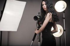 Stylish woman photographer Stock Image