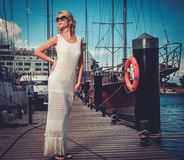 Stylish woman on a pier Stock Images
