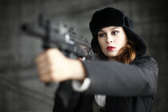 Stylish woman pointing rifle Royalty Free Stock Photo