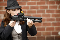 Stylish woman pointing shotgun Royalty Free Stock Image