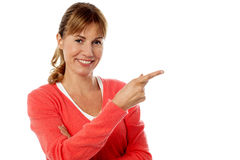 Stylish woman pointing at something Stock Images