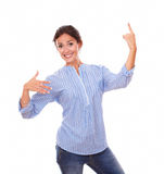 Stylish woman pointing up while standing Stock Photo