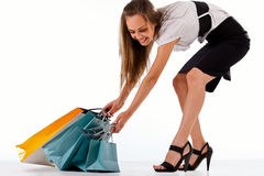 Stylish woman pulling shopping bags Stock Photography