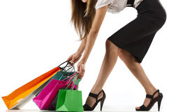 Stylish woman pulling shopping bags Stock Photo