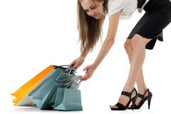 Stylish woman pulling shopping bags Stock Image