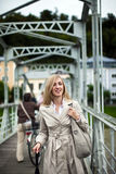Stylish woman in a raincoat Royalty Free Stock Image