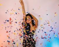 Stylish woman raises her hand Stock Images