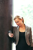 Stylish woman reading text messages Royalty Free Stock Photos